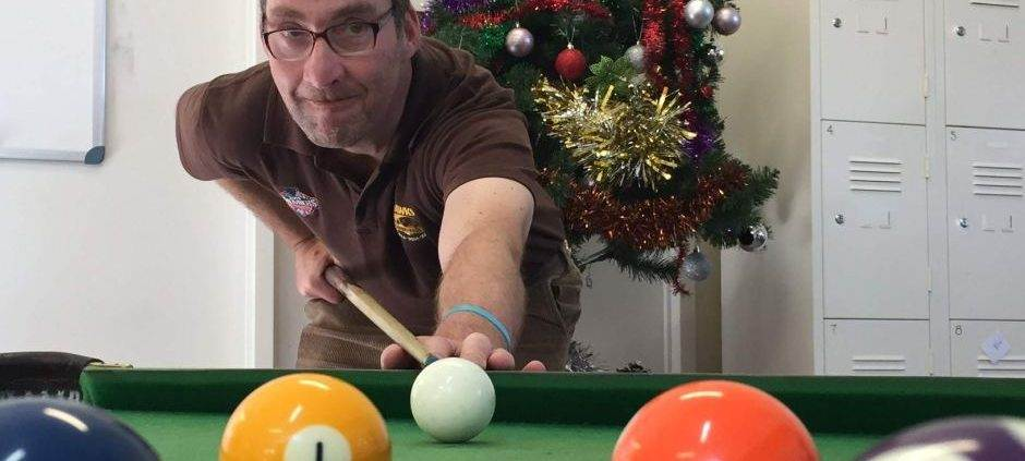 Simon Rolle Playing Pool
